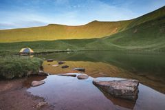 Beautiful landscape image of wild camping at base of Pen-y-fan i. Stunning Summer landscape of Pen-y-fan and wild camping in Brecon Beacons National Park Royalty Free Stock Image