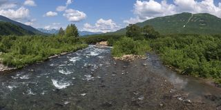 Stunning summer panoramic landscape of mountain river in Kamchatka Peninsula royalty free stock photos