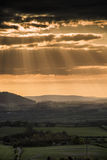 Stunning Summer sunset across countryside landscape with dramati Royalty Free Stock Photos