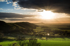 Stunning Summer sunset across countryside landscape with dramati Royalty Free Stock Photo