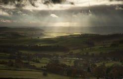 Stunning sun beams over Big Moor in Peak District National Park