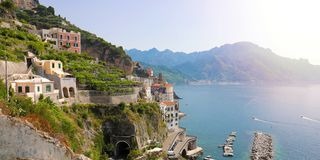 Stunning sunny day view of Atrani village overhanging the sea wi stock image