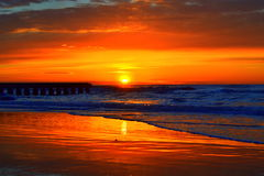 Stunning sunrise. Awesome flaming sunrise skies over the beach of Lido di Jesolo,Italy.Inspiring start of the day Stock Photo