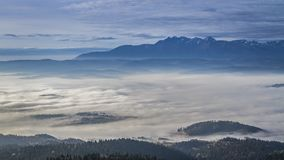 Stunning sunrise with flowing clouds in the Tatra mountains , Poland stock video footage