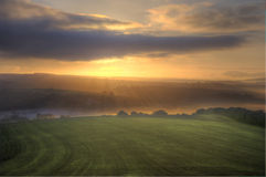 Stunning sunrise over fields landscape Royalty Free Stock Photos