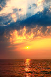 Stunning Sunrise Over The Sea. With fantastic sunbeam through the black stormy cloud stock image