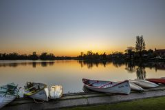 A stunning sunset on the boating lake in Thorpeness stock image