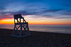 Stunning sunset on the empty beach, Cape Cod, USA. Watchtower and  amazing sunset on the empty beach, Cape Cod, USA Royalty Free Stock Image
