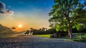 Stunning sunset at lake in District Lake, UK Royalty Free Stock Photo