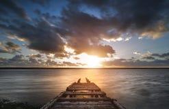 Beautiful vibrant sunset landscape image of Fleet Lagoon in Dorset England royalty free stock photos