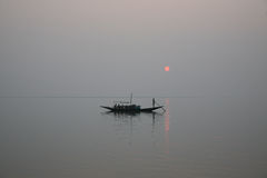 Stunning sunset looking over the holiest of rivers in India Stock Image