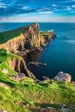 Stunning sunset at the Neist point lighthouse, Scotland Royalty Free Stock Photos