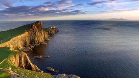 Stunning sunset at Neist point lighthouse, Scotland, United Kingdom stock footage