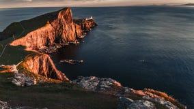 Stunning sunset at Neist point lighthouse, Scotland, United Kingdom, 4k, timelapse stock video