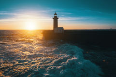 Stunning sunset on the ocean the lighthouse. Nature. Stunning sunset on the ocean the lighthouse Stock Images