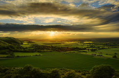 Stunning sunset over countryside landscape royalty free stock photos