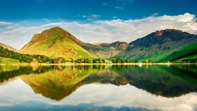 Stunning sunset over the lake and mountains in the Lake District, timelapse stock video footage