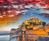 Stunning sunset over Mont Saint Michel, France.  Royalty Free Stock Photography