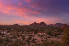 Stunning sunset over Phoenix, Arizona, Papago Park in foreground. royalty free stock photography