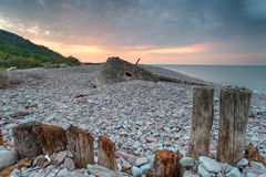 Stunning Sunset over Porlock Weir. Stunning sunset over the beach at Porlock Weir in Somerset, with an old WWII bunker in the background royalty free stock images