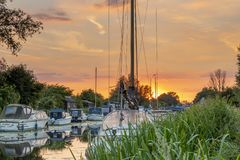 A beautiful sunset through the mast of a yacht on the river Chelmer in Essex stock images