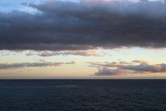 Stunning Sunset by the Sea Photographed in Madeira - Colorful Sky, Clouds and Calm Sea. Colorful landscape with a stunning sunset located in Funchal, Madeira stock images