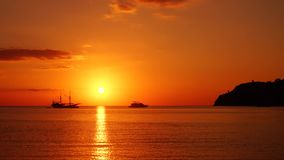 Stunning sunset on the tropical sea. Stunning sunset footage on the tropical sea with silhouette of boats in Labuan Bajo close to Bali Island, Indonesia stock video footage