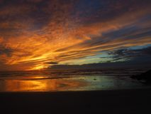 Incredible Sunset on the Pacific Ocean in Southern California. A stunning sunset with vibrant neon colors: pinks, purples, blues, and oranges taken at Grandview stock image