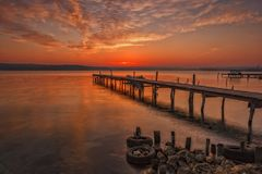 Stunning sunset with a wooden pier Royalty Free Stock Image