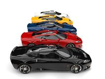 Stunning super sports cars in all gamut of colors - side view. Isolated on white background Stock Images