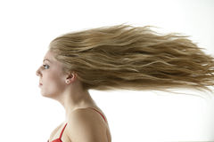 Stunning teenage girl with extreme blowing hair Royalty Free Stock Photography
