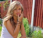 Stunning teenage girl in garden Stock Photo