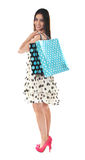 Stunning teenager carrying shopping bags Royalty Free Stock Photos