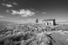Stunning toned black and white landscape image of Nun`s Cross Fa. Beautiful black and white landscape image of Nun`s Cross Farm in Dartmoor royalty free stock photography