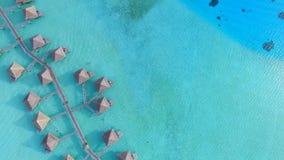 Stunning top 4k aerial view on bridge bungalow hotel in turquoise blue Pacific ocean water in Bora Bora island seascape. Stunning top aerial view on bridge stock video footage
