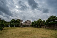 Stunning tulum mexico ancient civilization. Ancient mayan civilization in mexico called tulum in december 2017. Blue sky and green grass. One of the 7 wonders of Stock Photography