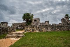 Stunning tulum mexico ancient civilization. Ancient mayan civilization in mexico called tulum in december 2017. Blue sky and green grass. One of the 7 wonders of Royalty Free Stock Images