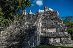 Stunning tulum mexico ancient civilization. Ancient mayan civilization in mexico called tulum in december 2017. Blue sky and green grass. One of the 7 wonders of Stock Photos