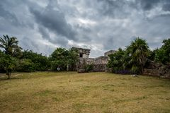 Stunning tulum mexico ancient civilization. Ancient mayan civilization in mexico called tulum in december 2017. Blue sky and green grass. One of the 7 wonders of Stock Image