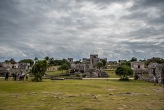 Stunning tulum mexico ancient civilization. Ancient mayan civilization in mexico called tulum in december 2017. Blue sky and green grass. One of the 7 wonders of Royalty Free Stock Photos