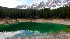 Stunning turquoise lake Carezza in the Alps at sunrise in spring, Italy stock video