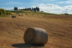 Stunning Tuscany landscape, typical stone house and hay bale on the hills,near Val d`Orcia, Italy, Europe Stock Image