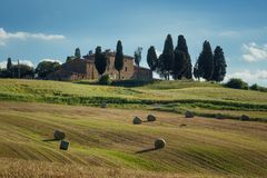 Stunning Tuscany landscape, typical stone house and hay bale on the hills,near Val d`Orcia, Italy, Europe Royalty Free Stock Photos