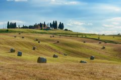 Stunning Tuscany landscape, typical stone house and hay bale on the hills,near Val d`Orcia, Italy, Europe Stock Images