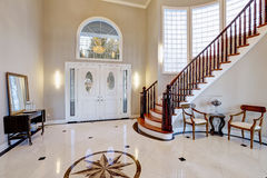 Stunning two story entry foyer with marble mosaic tiled floor Royalty Free Stock Image