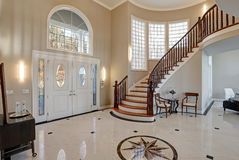 Stunning two story entry foyer with marble mosaic tiled floor Stock Photo