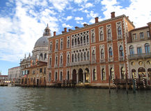 Stunning Venetian Style Architectures and the Basilica di Santa Maria della Salute along the Grand Canal of Venice. Italy Royalty Free Stock Images
