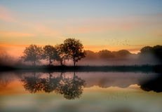 Stunning vibrant Autumn foggy sunrise English countryside  Royalty Free Stock Photography