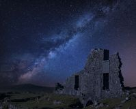 Stunning vibrant Milky Way composite image over abandoned Foggintor Quarry in Dartmoor with raking soft sunlight over ruins and royalty free stock photos