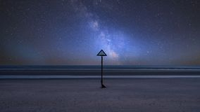 Vibrant Milky Way composite image over landscape of beautiful lo. Stunning vibrant Milky Way composite image over landscape of beautiful long exposure sea and Royalty Free Stock Images